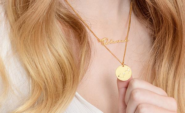 Zodiac Necklace worn by a woman
